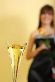 Vetro e donna di Champagne Fotografia Stock