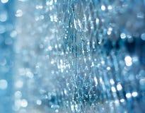 Vetro tagliato blu con struttura di effetto del bokeh fotografia stock libera da diritti