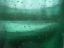 Vetro verde con le bolle Immagine Stock