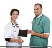 Vets holding a digital tablet Royalty Free Stock Photos