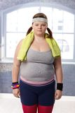 Vette vrouw in sportkleding Stock Afbeelding