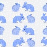 Vettore senza cuciture dei conigli e della neve di struttura Fotografie Stock
