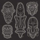Vettore, siluetta bianca, insieme delle maschere tribali etniche africane, tatuaggio Immagine Stock Libera da Diritti