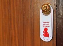 Veuillez ne pas toucher à l'étiquette d'hôtel sur la trappe Photo stock