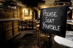 Veuillez s'asseoir Photo libre de droits