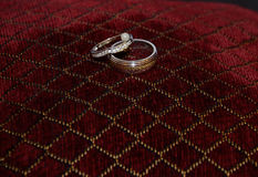 Vevet pillow with wedding rings Stock Photo