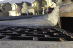 Vew of gutter and storm drain in neighborhood Royalty Free Stock Image