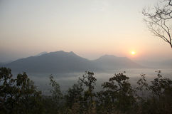 Vew of phu tok mountain with mist and sun at viewpoint in morning Royalty Free Stock Image
