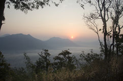 Vew of phu tok mountain with mist and sun at viewpoint in morning Stock Photo
