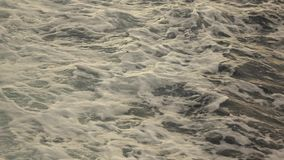 Vew of storm sea waves roll from movind ship at the summer day. Slow motion, Full HD video, 240fps, 1080p. Great seascape scenic with large foam waves from stock video footage