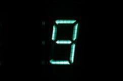 VFD digit. Vintage vacuum fluorescent display (VFD) digit 9 Royalty Free Stock Image