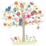 Vögel und Katzen auf dem Baum Auch im corel abgehobenen Betrag Stockfotos