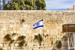 Vägg för ` för israelisk ` för flagga västra att jämra sig av den forntida templet Jerusalem Israel Royaltyfri Fotografi