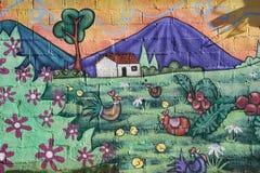 Väggmålning på ett hus på Ataco i El Salvador Arkivfoto