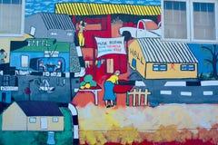 Väggmålningen berättar berättelsen av Swakopmund Royaltyfri Fotografi