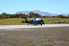 VH-60, Robben Island, South Africa. Photo was taken in 2013, VH-60 shutting down on Robben Island South Africa. The background mountain is Table Mountain in Stock Photos