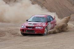 Véhicule rouge Mitsubishi Lancer de rassemblement Images libres de droits