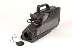 VHS Camcorder. Full sized VHS Camcorder with lens cap off, photographed on a white background Stock Images