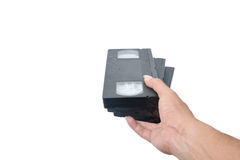 VHS cassette in hand Royalty Free Stock Images