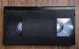 VHS tape on wooden table Stock Images