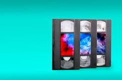 VHS video cassettes on a blue background. stock photos