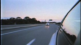 VHS vintage film tape effect - defocused view from car in motion. Mallorca, Baleares, Spain - Circa 2019: Renault car VHS vintage film tape effect - defocused stock video