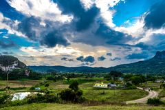 Viñales valley view in Cuba. Unreal nature with lakes, mountain, trees, wildlife. Gorgeus sky. Viñales valley view in Cuba. Unreal nature wih lakes, mountain Stock Image