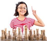 下棋VI的小女孩 图库摄影