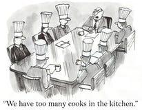 Vi har för många kockar i kök Arkivbild