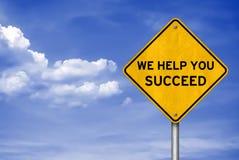 Vi hjälper dig att lyckas Arkivbild
