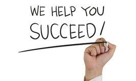 Vi hjälper dig att lyckas, begreppstypografi Arkivfoto