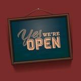 Vi är det öppna tecknet Arkivfoto