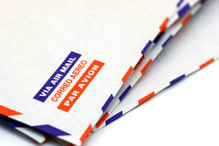 Via aerea. Envelope with the words air mail in different languages with a shallow depth of field and in perspective Royalty Free Stock Images