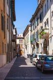 Via Augusto Verita in historical center of Verona. VERONA, ITALY - MARCH 27, 2017: tourists on Via Augusto Verita in historical center of Verona town. Verona is Stock Images
