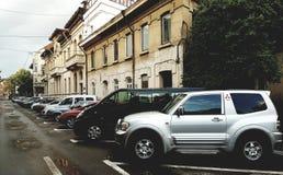 Via con le automobili a Bucarest Fotografia Stock Libera da Diritti