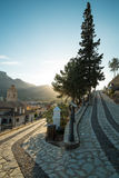 Via crucis. Old via crucis winding uphill with a chruch tower in the background Royalty Free Stock Images