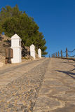 Via crucis, Polop. Steep street following a via crucis uphill Royalty Free Stock Images