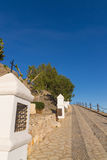 Via crucis. Steep street following a via crucis uphill Stock Images