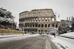 Via dei Fori Imperiali and the Colosseum with snow. This picture was taken february 4th 2012, after one of the heaviest snowfall in Rome since 1985. This is the Stock Images