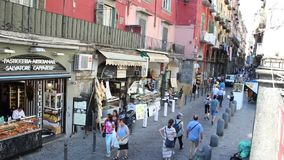 Via dei Tribunali in Naples. AT NAPLES ITALY - ON 07/08/2017 - people walking along Decumano Maggiore, Via dei Tribunali in the historical center of Naples stock video footage