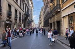 Via del Corso, Roma. The central street of via del Corso in Rome with shops and walking people Stock Images