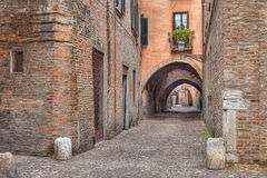 Via delle Volte, medieval alley in Ferrara, Italy Stock Photography