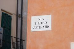 Dietro Anfiteatro street name sign, Verona. Via Dietro Anfiteatro street name sign, near Piazza Bra, the largest piazza in Verona, Italy royalty free stock images