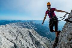 Via ferrata climbing. Young girl climbing via ferrata Stock Images