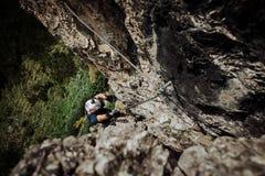 Via Ferrata die in Oostenrijk beklimmen stock foto's