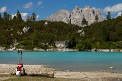 Via Ferrata equipment. (trekking poles, helmet) with Sorapis lake on background, Italy Royalty Free Stock Image