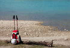 Via Ferrata equipment. (trekking poles, helmet) with Sorapis lake on background, Italy Royalty Free Stock Photo