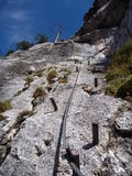 Via ferrata steel rope on a rock Royalty Free Stock Photos