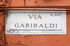 Via Garibaldi, street plate on a wall in Rome Royalty Free Stock Images