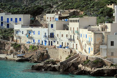 Via Grotte Levanzo - Egadi islands. Houses on the sea in the small fishing village of levanzo - Sicily Royalty Free Stock Photo